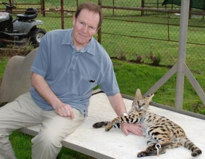 Michael (creator of this website) with tame serval at A1 Savannahs - photo by Kathrin Stucki.