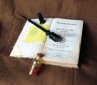 An old book on Homeopathy with a remedy in a bottle - photo by ausphoto (a.k.a. heritagefutures)