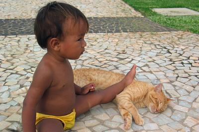 Child and Cat Together - photo by irene nobrega